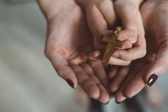 Family prayer with wooden rosary Royalty Free Stock Images