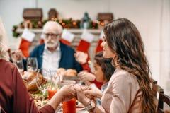family praying before christmas dinner stock image
