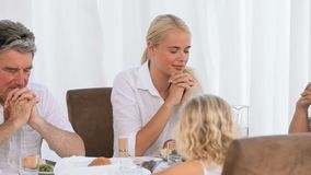 Family praying before dinner Royalty Free Stock Image