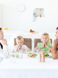 Family praying during their lunch. In the kitchen royalty free stock photos