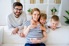 Family with pregnant mother. A portrait of a family with pregnant mother Stock Photos