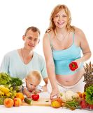Family pregnant woman preparing food . Royalty Free Stock Images