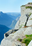 Family on  Preikestolen massive cliff top (Norway) Royalty Free Stock Photography