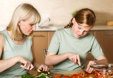 Family preparation of meal Stock Image