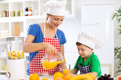 Family prepare fresh orange juice Stock Photo