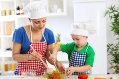 Family prepare lettuce for meal Stock Images