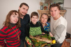 Family and the prepared fish. Stock Photos