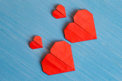 Family prepared for Valentine's Day. Origami of heart. Concept. Family prepared for Valentine's Day. Origami of heart. Concept of family. Point of view shot royalty free stock images