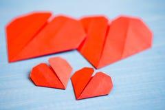 Family prepared for Valentine's Day. Origami of heart. Concept. Family prepared for Valentine's Day. Origami of heart. Concept of family. Point of view shot stock photo