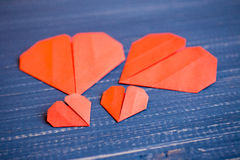 Family prepared for Valentine's Day. Origami of heart. Concept. Family prepared for Valentine's Day. Origami of heart. Concept of family. Point of view shot royalty free stock photo