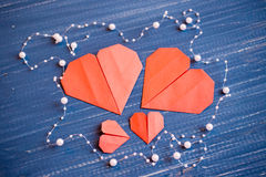 Family prepared for Valentine's Day. Origami of heart. Concept. Family prepared for Valentine's Day. Origami of heart. Concept of family. Point of view shot royalty free stock photos