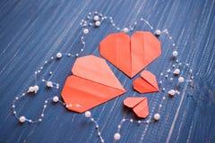 Family prepared for Valentine's Day. Origami of heart. Concept. Family prepared for Valentine's Day. Origami of heart. Concept of family. Point of view shot stock image