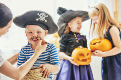 Family prepares for Halloween Stock Photo