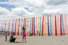 Family prepares a kite for the flight. Royalty Free Stock Image