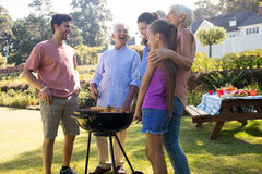 Family preparing barbecue in the park. Happy family preparing barbecue in the park Royalty Free Stock Image