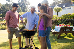 Family preparing barbecue in the park. On a sunny day Royalty Free Stock Image