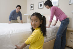 Family Preparing Bed Together Royalty Free Stock Photo