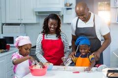 Family preparing cake. In kitchen Stock Image