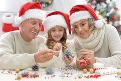 Family preparing for Christmas Stock Images