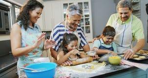 Family preparing cookies in the kitchen 4K 4k