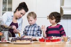 Family Preparing Cupcake Royalty Free Stock Photos