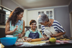 Family preparing dessert in kitchen Royalty Free Stock Photos