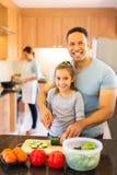 Family preparing dinner Royalty Free Stock Photo