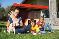 Family preparing the doghouse for the new family member. A labrador puppy Royalty Free Stock Photography