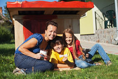 Family preparing the doghouse waiting for the new family member Royalty Free Stock Image