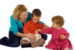 Family preparing for easter. Young mother and children with a bunny (easter theme, isolated royalty free stock photo