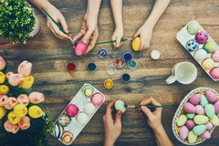 Family preparing for Easter. Happy easter! A mother, father and their daughter painting Easter eggs. Happy family preparing for Easter