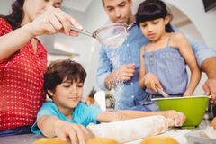 Family preparing food at home. Low angle view of family preparing food at home Royalty Free Stock Photo