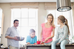 Family preparing food in kitchen Stock Image