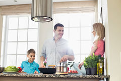 Family preparing food in kitchen Royalty Free Stock Image