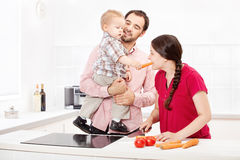 Family preparing food in the kitchen. Happy family preparing food in the kitchen Stock Photography