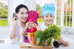 Family preparing food together Stock Photos