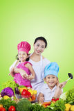 Family preparing fresh vegetables Stock Photos