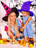 Family preparing halloween food. Mother with daughter preparing halloween food Stock Photo