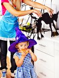 Family preparing halloween food. Mother with daughter preparing halloween cake Royalty Free Stock Photography