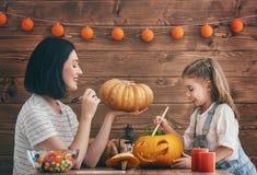 Family preparing for Halloween. Stock Photo