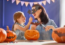 Family preparing for Halloween. Royalty Free Stock Photography