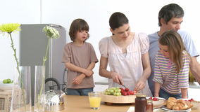 Family preparing a healthy breakfast in the kitchen stock video footage