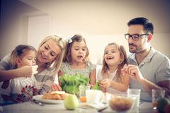 Family preparing healthy eat. Young happy family preparing healthy eat together. Space for copy stock photos