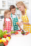 Family preparing healthy meal Royalty Free Stock Photos