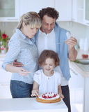 Family preparing healthy meal in kitchen Stock Image