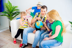 Family preparing for the journey. Family prepare for the journey looking at globe Stock Photo