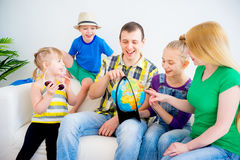Family preparing for the journey. Family prepare for the journey looking at globe Stock Image
