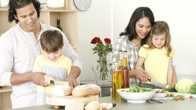 Family preparing a meal in the kitchen Royalty Free Stock Photography