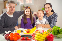 Family preparing meal. Mealtime together at home Stock Photography