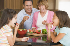 Family Preparing Meal Together. Grandparents and Grandchildren Preparing Meal Together stock photo